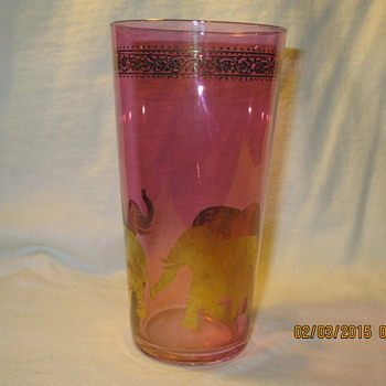 purple colored drinking glass with gold etching and elephants