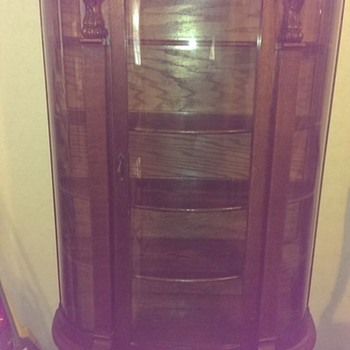 Triple Panel Curved Glass Curio Cabinet Hand Carved Lions Heads