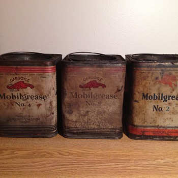Greasy, Rusty, Dented Gargoyle Mobilgrease Cans