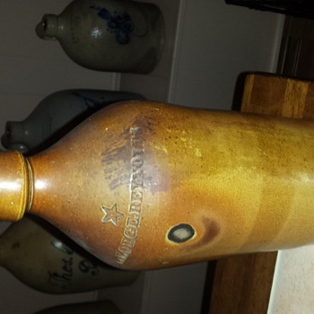 George Reynolds stoneware bottle with star - Bottles