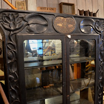 Arts and Crafts style carved display cabinet