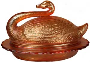 A novelty Covered Swan butter dish from the English maker, Sowerby. The mould for this piece dates back to the 1880s, although it was made in Carnival some 40 or so years later.