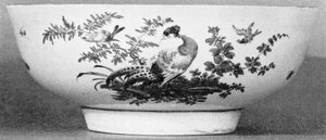 A Worcester Bowl: Of the Dr. Wall period, because the decoration includes exotic Chelsea birds, it dates after decorators from that pottery came, in 1768, to work at Worcester.