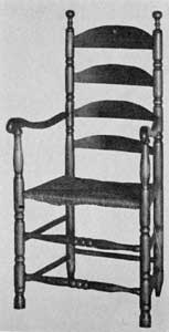 18th-Century Chair: The decorative turning of uprights, finials, front stretchers, and shaping of the arms are typical of the finer chairs made in New England during this period.