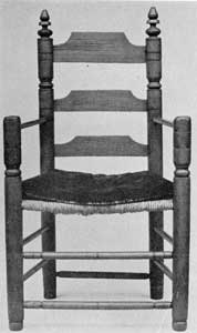 A 17th-Century New England Chair: It was made circa 1675. The heavy uprights and the broad, straight-cut slats and very simple arms are characteristics of the first slat-backs made in America. The wood is maple and ash