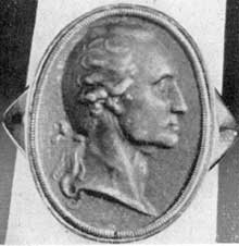 ILLUSTRATION II: A Berlin Casting Ring: Originally owned by General Daniel Keim of Reading, Pa., it was erroneously considered as a pallbearer's token. Size 14/16 by 10/16 inches, the same as the Lear brooch and pin, showing another use of the same oval portrait bust; miniature made of iron.
