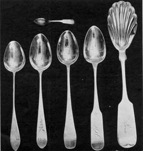 Typical American Silver Spoons: The group shows the style transition from the late 18th Century to the middle of the 19th Century. At the upper left hand is a doll's size fiddleback spoon made in New England after 1850.