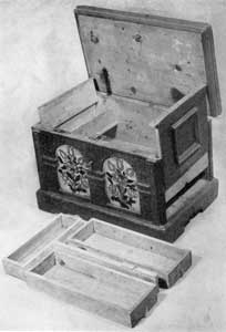 ILLUSTRATION V: A Pennsylvania Painted Chest: The right end, that is movable, has been raised to show the drawers concealed in the false bottom. These are arranged as they fit into the space in front of this miniature chest.