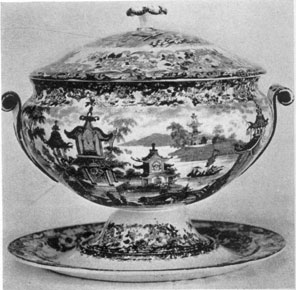 A Wedgwood Tureen, Circa 1820: Circular, and decorated in dark blue with a Chinese design, it has a separate tray that serves as the base.