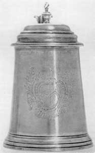 Benjamin Burt Tankard, 1756: This was made for Captain John North and shows the arms of North impaling Piston.