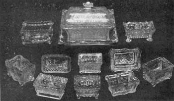 Characteristic Designs in the Oblong Shape: For comparison, in center top row, is the rare Lacy Sandwich covered relish dish with tray in Gothic design. The tray is 7-1/8 inches long and the piece 5 inches to top of knob. Immediately below is a Gothic-pattern salt dish. The two in the bottom row have double compartments.