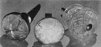 Cut Glass and Cast Compared: The two with cut-glass faces are mounted in brass bases. One retains the reflecting mirror behind the glass so that it appears to be of opalescent glass. At the right a cast-glass knob of intricate geometric pattern that seems to be also of lacy Sandwich in its design.