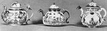 Illustration V (A, B, C): Dresden Teapots Showing Development in Design: A — Made circa 1712-1715 and unmarked, was decorated with engraved gold foil attached with lacquer. B — Made 1720 and unmarked. Here the decoration was fired gold. C — Made circa 1725 and marked with the crossed swords. The decoration is polychrome painting in frames of iridescent purple. These are each six inches wide.