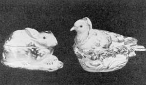 Illustration I: Examples from Derby and Chelsea: These two table accessories were used as either a sauce tureen or a sugar box. Both are decorated in natural colors. They are splendid examples of the use of the rabbit and the dove in ceramic decoration.