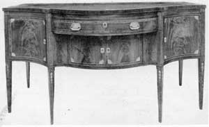 A New York Sideboard, Circa 1790: Here the inlay ornamentation is distinctive, particularly the bellflower pendants that decorate the legs.