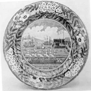 "A ""Landing of Gen. Lafayette"" Plate: The blue-and-white Staffordshire transfer-ware service, of which this plate is a part, was made by James and Ralph Clews, whose pottery was at Cobridge. It was produced shortly after General Lafayette made his return visit to the United States in 1824 as guest of the nation. The view, showing the Battery Park, New York, Castle Garden, and welcoming ships, was taken from a contemporary engraving made by Samuel Maverick, an impression of which must have been sent to the Clews pottery almost as soon as this print was issued."