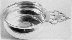 Porringer by Paul Revere I: He was apprenticed to John Coney. The handle of this piece is typical in shape and design of those used by New England silversmiths of the period.