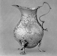 Pre-Revolutionary Revere Silver: Cream Pot made for Lucretia Chandler. Her husband, John Murray, a loyalist, fled to Nova Scotia. Their ship was overtaken by an American privateer and this cream pot was brought to Boston where it was sold at a prize court auction.