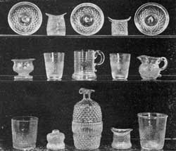 Illustration II: Rarities in Blown-Molded Glass: Outstanding are the three small sauce plates in the top row; the two miniature flip glasses and the mug with handle in the center row; and two tumblers and the ink well in the bottom row.