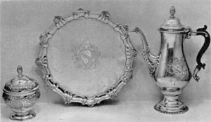 Revere Silver in Rococo Style: The sugar bowl and tray bear the Chandler coat-of-arms and the coffee pot that of the Sargent family.