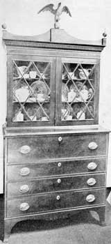 Secretary Attributed to The Appletons: The carved eagle finial, shaping of the cornice, and diamond paned doors, are all like those found on other pieces of Salem origin.