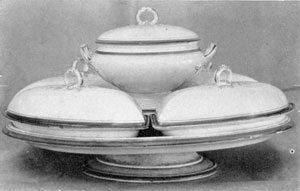 Tureen and Vegetable Dishes: By Wedgwood, circa 1850, the tureen and four covered vegetable dishes are mounted on an unusual porcelain Lazy Susan.