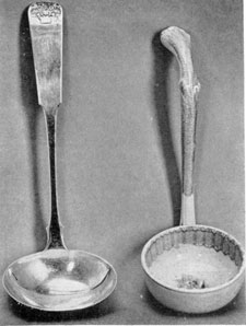 Two Tureen Ladles: At the left: one of silver by J. B. Jones, Boston, Mass., 1782-1854. It bears the basket-of-flowers decoration on the handle and is the type used with many Staffordshire tureens. At the right: a china ladle of the late Staffordshire period, by T. Fell & Co.