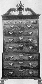 3. Superb cabinetmaking is evident in this chest-on-chest, c. 1775. Note the fine proportions, the carved ornamental pediment and beautiful grain of the mahogany.