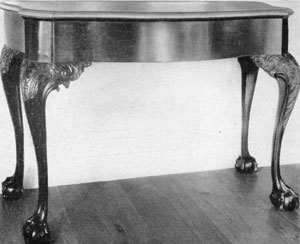 5. Pier or side table with marble top. Note combination of smooth serpentine front with deeply carved (acanthus leaf) knees and brackets. C. 1770.