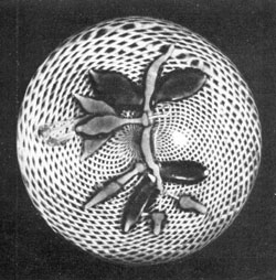 A Baccarat Fuchsia: Here the design of blooms, buds, leaves, and supporting stem rests on latticinio interlacing white threads of circular pattern.