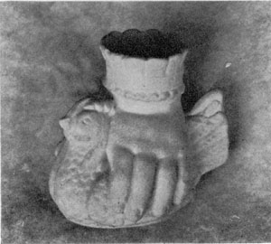 A Child's Vase of Parian: An unusual design. Here the hand holds a chicken with wrist forming vase. Hand supporting a flower cup is oftener found.