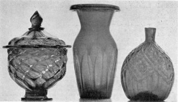 Stiegel-Type Colored Glass: Left to right: a quilted, covered sugar bowl; a panel vase; and a diamond daisy perfume bottle.