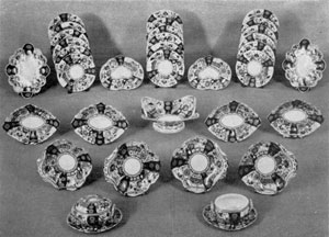A Crown Derby Dessert Service: The decoration is in the Imari style. The panels are underglaze, done in blue, ferro-red, green, light blue, gold, and other colors. This service was made circa 1800.