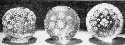 Three Millefiori Glass Doorknobs: That at the left has been faceted on a cutting wheel to make it more nearly square. The one in the center and that at the right are typical of the millefiori paperweights made at American factories — probably Sandwich. All have shanks at the base so that they could be mounted in brass for use as decorative hardware.