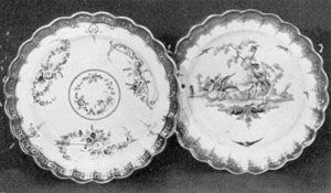 Dr. Wall Worcester Porcelain Plates: Scalloped shapes with decorations of flowers and exotic birds done in naturalistic coloring, the rims have cobalt-blue banding overlaid with gold. Made circa 1765.