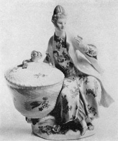 An Early Meissen Piece: The design is of a woman seated beside a covered basket. The decoration is in the Chinese manner. It was made circa 1745.