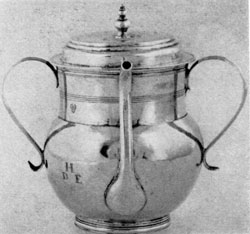Illustration I: Early Spout Cup: By Jeremiah Dummer, Boston, 1645-1718, this piece with two handles, nicely curved, spout and lid with finial is characteristic of the simplicity of 17th-Century American silver.