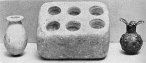 Illustration I: Beauty Kit, Mesopotamian, 3000 B.C. Perfume Bottle, Alabaster, Egypt, 135o B.C. Perfume Bottle, Silver, Arabian, 500 A.D.