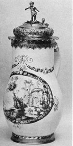 """Illustration II: Fayence Jug by Shaper: An example of """"Schwarzlot"""" painting done circa 5665, the piece has copper-gilt mountings."""