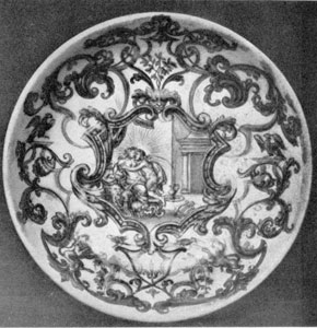 Illustration VI: B. F. Bottengruber, Breslau, C. 1730: The decoration is a central mythological scene surrounded by elaborate scroll work done in gold which completely covers this saucer.