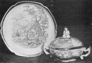 Illustration VII: By Jacob Helchis, Circa 1747: A plate and cover dish decorated with a formalized landscape, deer and hunters. Note the finial in the form of a Chinese man.