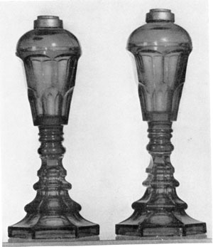 Glass Lamps from Sandwich: Of cobalt blue in color, these pressed glass lamps were originally used for whale oil. They are typical of the vase shapes made between 1830 and 1845.