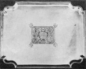 2. Superb example of Augustine Courtauld's achievement of fine form by beautiful proportions and bold, clear outline. A tray dating 1721-24. Width, 211/2 in. Weight, 125 ounces. Sold in 1945 for $6,800.
