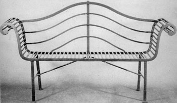 A Lyre Bench in Adam Simplicity: Made circa 1795, it typifies the grace and restraint of that classic style, but also employs serpentine curves for the back and bold outward curves for the arms. The transverse slats of the seat and the arms are unusual.