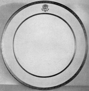 Plate from the Wilson Service: This White House dinner service was decorated with etched gold borders and the presidential seal of raised gold paste. The service was also used during the Harding, Coolidge and Hoover administrations.