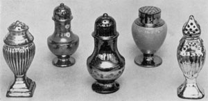 Silver and Copper Lustreware: All of English pottery, the three pepper pots in the center are of copper lustre; those at the outer left and right are of silver lustre.