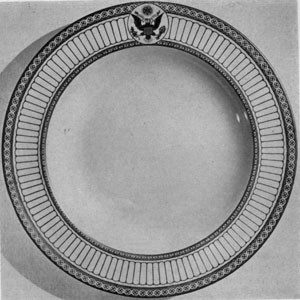 A Theodore Roosevelt Plate: This large dinner service was made by the Wedgwood Potteries in England. The form was adapted from simple one of the colonial period. The decoration was of gold with United States seal executed in natural colors.