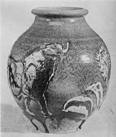 Illustration V: Vase with Drip Glaze: Made by John Dee Wareham, it has a rugged turquoise dry glaze applied to a terra cotta body. The design shows a bull and some trees. About 1915 Rookwood ceased to make many pieces of terra cotta body.