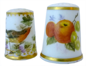 Royal Worcester. Left: Unmarked and unsigned 1870s handpainted robin RW thimble of translucent porcelain. Right: Modern handpainted signed fruit by Joan Rayner. The thimble dates between 1964-1986, when RW ceased making h/p thimbles
