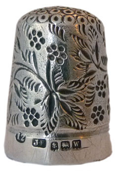"James Fenton is known for his blackberry designs - here with an all over pattern of leaves with the berries. There are also stylised berries on the apex. Marked with size 12,""JF"" maker's mark, assay mark for Birmingham 1921."
